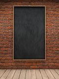 Blackboard on brick wall Royalty Free Stock Images