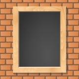 Blackboard on brick wall. Stock Image