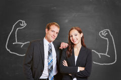 Blackboard with business couple stock photography