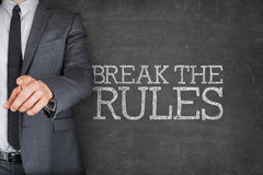 On blackboard with businessman Stock Images