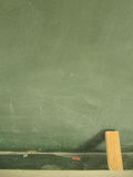 Blackboard with chalk and eraser Royalty Free Stock Image
