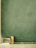 Blackboard with chalk and eraser Stock Photos