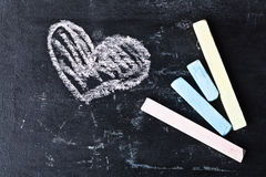 Blackboard, chalk and heart Stock Images