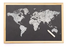 Blackboard with a chalk and the map of the world drawn onto. (se Royalty Free Stock Image