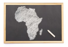 Blackboard with a chalk and the shape of Africa drawn onto. (ser Royalty Free Stock Image