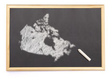 Blackboard with a chalk and the shape of Canada drawn onto. (series) royalty free stock photography