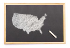 Blackboard with a chalk and the shape of USA drawn onto. (series Royalty Free Stock Photography