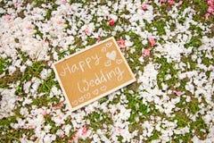 Blackboard. Chalk text wedding decoration on petals Royalty Free Stock Image