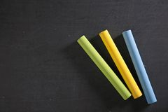 Blackboard and chalk Stock Images