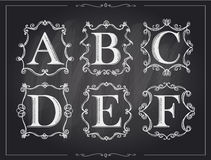 Blackboard chalk vintage calligraphic letters in monogram retro frames, alphabet logos Royalty Free Stock Photo