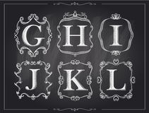 Blackboard chalk vintage calligraphic letters in monogram retro frames, alphabet logos Royalty Free Stock Photography