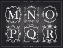 Blackboard chalk vintage calligraphic letters in monogram retro frames, alphabet logos Royalty Free Stock Photos