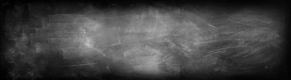 Blackboard or chalkboard. Chalk rubbed out on blackboard background Stock Images