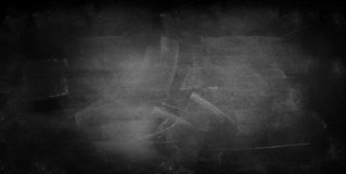 Blackboard or chalkboard. Chalk rubbed out on blackboard background Royalty Free Stock Photos
