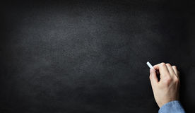 Blackboard or chalkboard with hand writing in chalk Royalty Free Stock Images