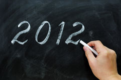 Blackboard / chalkboard with a handwriting of 2012 Stock Image