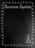 Blackboard or Chalkboard menu with the words Christmas Specials. Holiday menu board with copy space for your text Royalty Free Stock Image