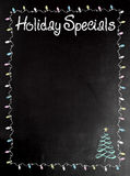 Blackboard or Chalkboard menu with the words Holiday Specials. For a seasonal menu Stock Photo