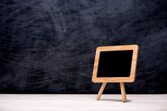 Blackboard / chalkboard texture. Empty blank black chalkboard with chalk traces Royalty Free Stock Images