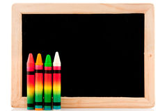 Blackboard with chalks Stock Photography