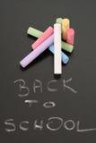Blackboard and chalks royalty free stock image