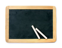 Blackboard and chalks Stock Images