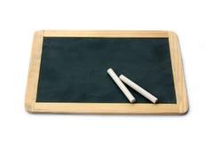Blackboard and chalks Stock Photo