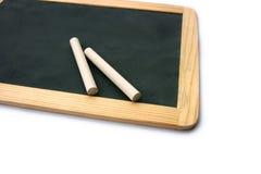Blackboard and chalks Stock Photography