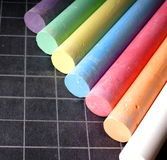 Blackboard and chalks Stock Photos