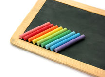 Blackboard and chalks in rainbow Royalty Free Stock Images