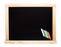 Blackboard with chalks Stock Photo