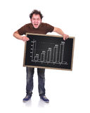 Blackboard with chart. Angry man holding blackboard with drawing chart Stock Image