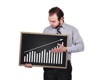 Blackboard  with chart. Businessman holding blackboard  with drawing chart Royalty Free Stock Images