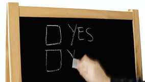 Blackboard check yes yes. A hand writing two Yes boxes on a blackboard and checkmarking both stock footage