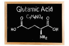 Blackboard with the chemical formula of Glutamic acid Royalty Free Stock Images