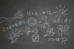 Blackboard with the children's drawings Stock Photos