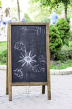 Blackboard with children's drawings. Blackboard with children's drawings on the street outside a cafe Royalty Free Stock Photo