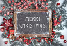 Blackboard with Christmas decorations on snow, text Stock Photography