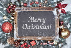 Blackboard with Christmas decorations on snow, text Stock Image
