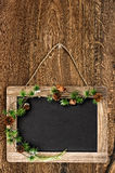 Blackboard with christmas tree branch decoration Stock Photo