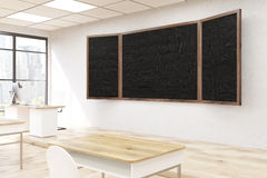 Blackboard in classroom. Blackboard in modern classroom interior. Wooden desks, plastic chairs. Concept of presentation. Back to school. 3d rendering. Mock up Stock Photography