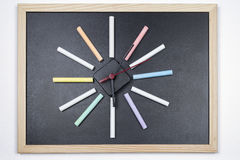Blackboard with colored chalks Royalty Free Stock Image