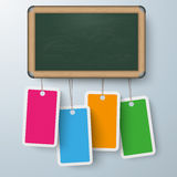 Blackboard 4 Colored Price Stickers. Blackboard with 4 colored price sticers on the gray background Royalty Free Stock Image