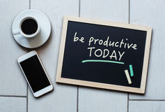 Blackboard concept saying Be Productive Today. Chalkboard or Blackboard concept saying Be Productive Today with coffee and mobile phone. Business, Education stock image