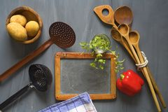 Blackboard  for cooking recipes,. Blackboard for cooking recipes, kitchen utensils, food ingredients, free copy space, cooking concept Stock Photo