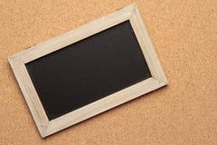 Blackboard on cork background Royalty Free Stock Images