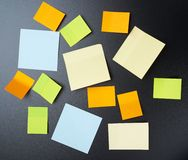 Blackboard covered with sticky notes Stock Photos