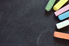 Blackboard with crayons Royalty Free Stock Photography