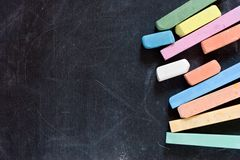 Blackboard with crayons Stock Photos