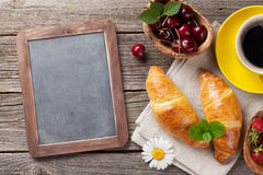 Blackboard, croissants and coffee Royalty Free Stock Photography